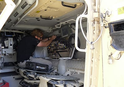technician in a military vehicle