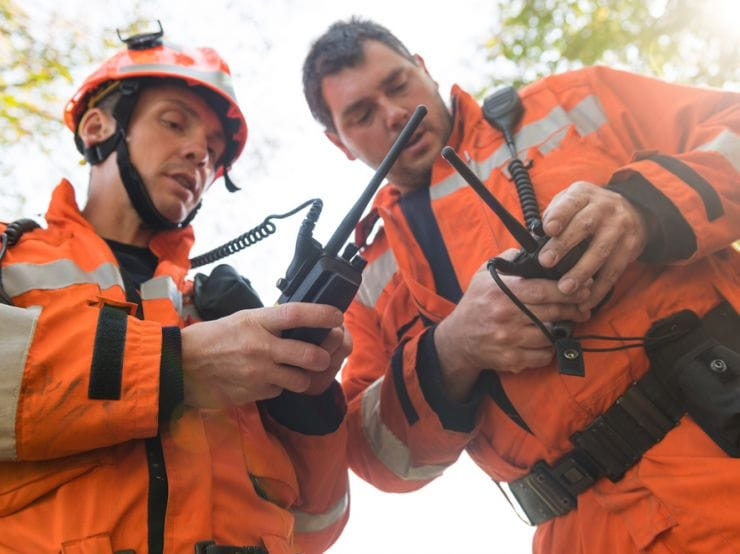picture of fire fighters using walkie talkies
